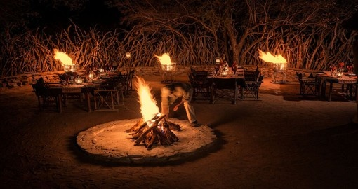 Enjoy a delicious boma dinner at Impodimo Game Lodge during your trip to South Africa.