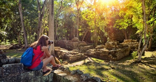 Woman photographing ancient Mayan ruins in Copan