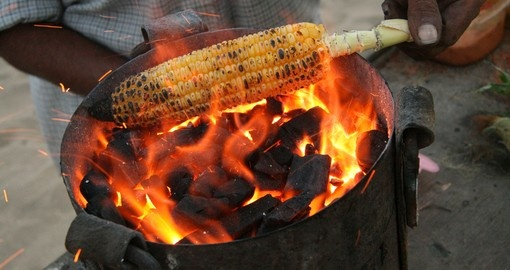 Roasting corn on Chowpatty Beach