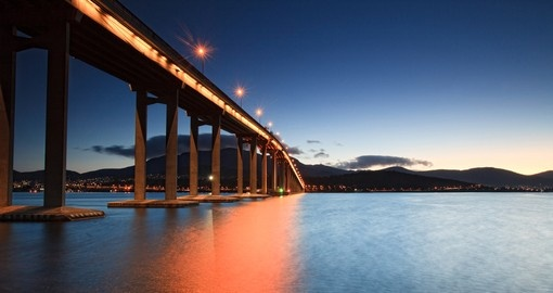 Experience Tasman bridge at sunset on your next Australia vacations.