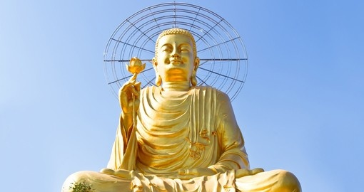 Visit the giant sitting golden buddha on your vietnam tour package