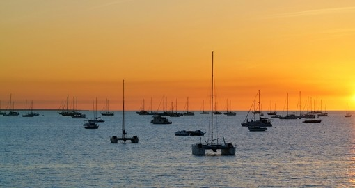 Enjoy a relaxing catamaran ride through Fannie Bay at sunset during your Australia Vacations.