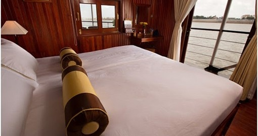 Relax in your spacious cabin on your Cambodia Tour