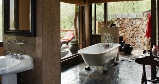 Enjoy all the deluxe amenities of the Ebony Lodge during your next South Africa safari.