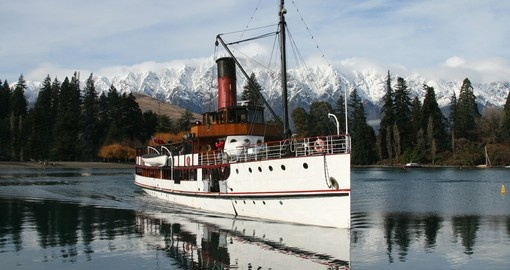 Steamer boat on lake at Queenstown is a great day trip to do while on your New Zealand vacation.