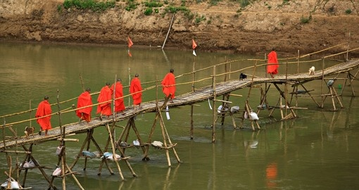 Crossing the river with a bamboo bridge