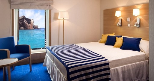 Relax in your Double Room on your Galapagos Cruises