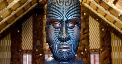 Maori meeting house near the treaty house in Waitangi is a great photo opportunity on your New Zealand vacation.
