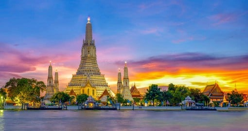 Wat Arun or the Temple of Dawn, sits majestically on the Chao Phraya River in Bangkok