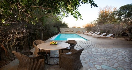 Enjoy the pool at Kapama Buffalo Camp while on vacation in South Africa.