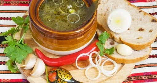 Russian tradition soup with bread and garlic