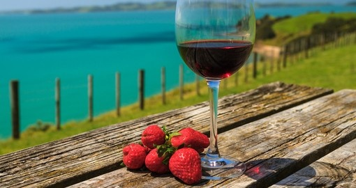 Glass of red wine with strawberries