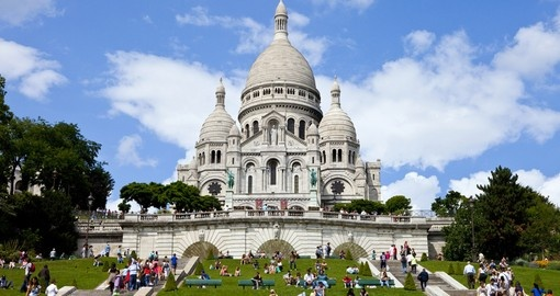 Sacré-Cœuris located at the summit of Montmartre, the highest point in Paris