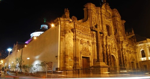 Beautiful La Compania Church at night in downtown Quito on your next trip to Ecuador.