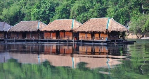 Check out the Floating Hotel Houses on Kwai River on your trip to Thailand