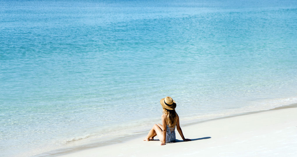 Woman on beach in Whitsundays