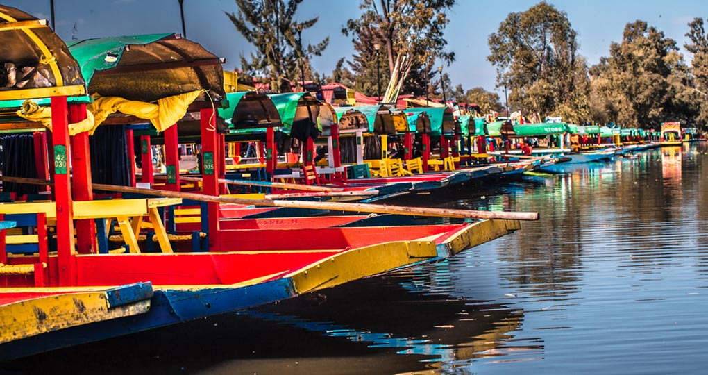 Traditional Mexican trajinera boats in Xochimilco channels